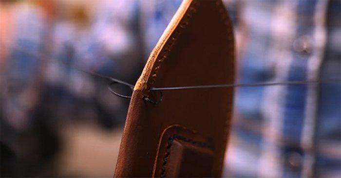 ручной шов на кожаных ножнах для ножа