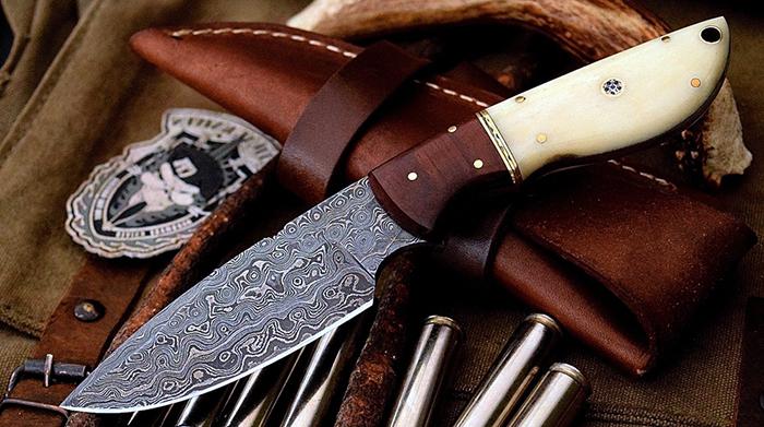 нож с накладками на рукояти из кости